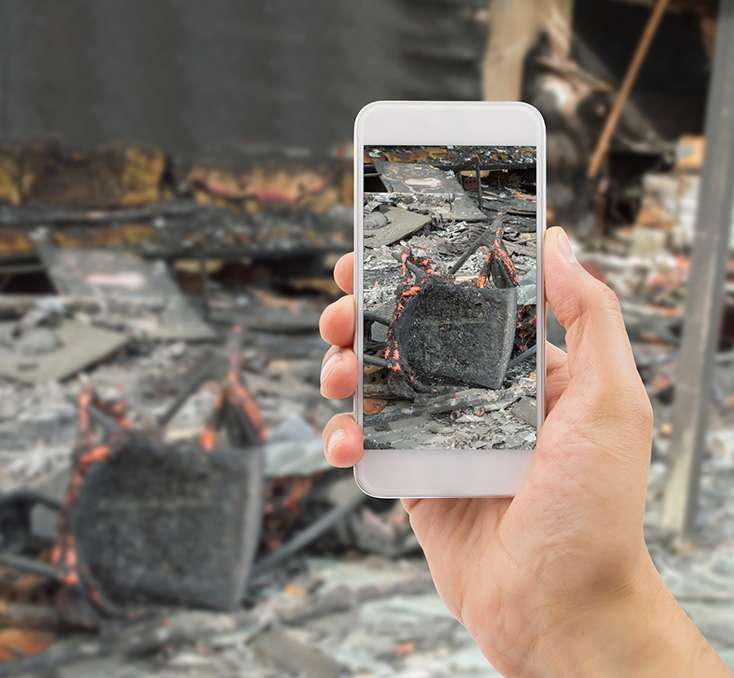 taking photo of fire damage