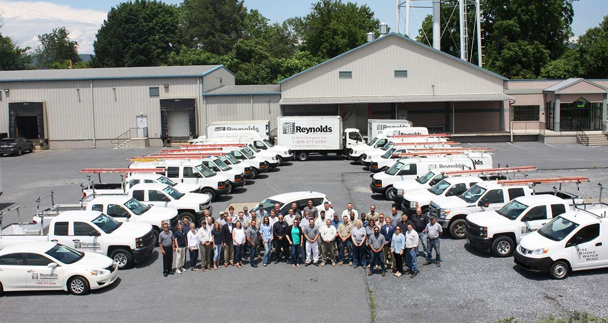 group of employees at reynolds restoration services